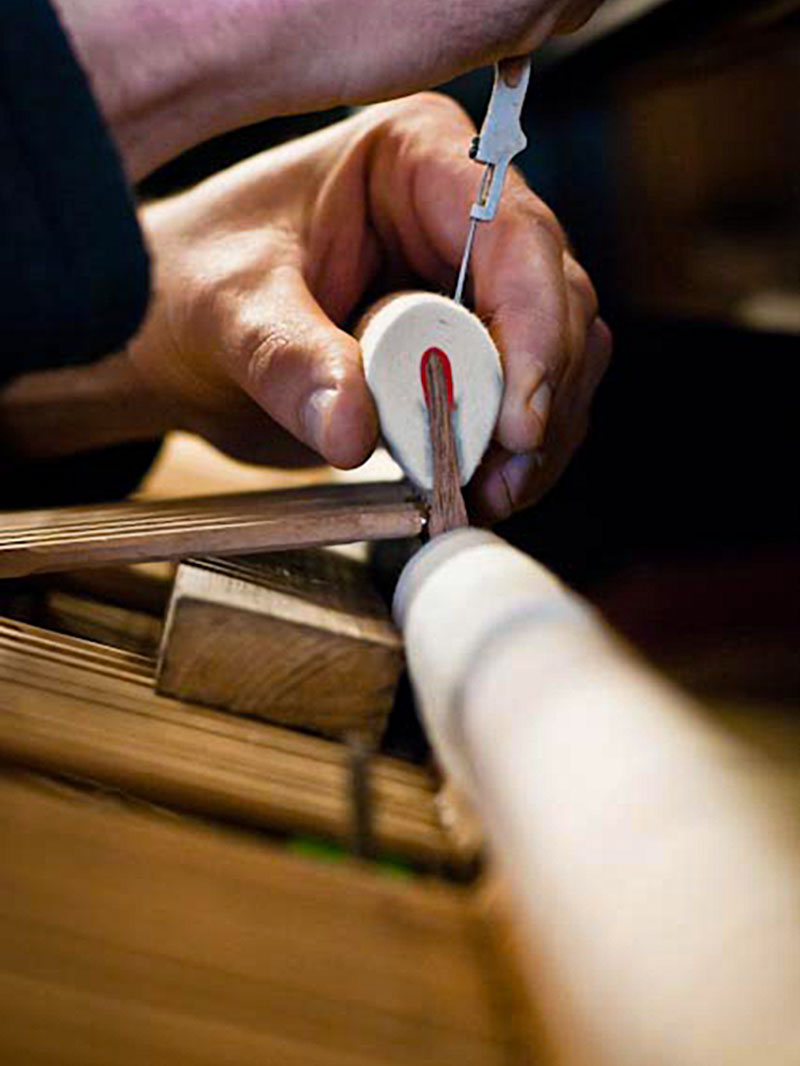 Hand checking piano hammer