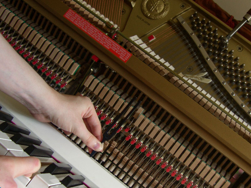 Piano tuning with socket wrench