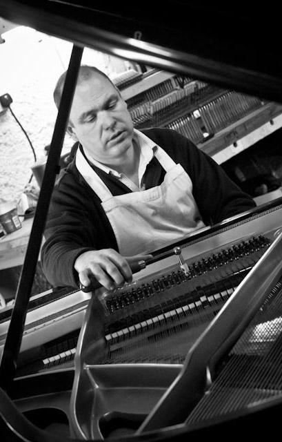 John tuning a grand piano